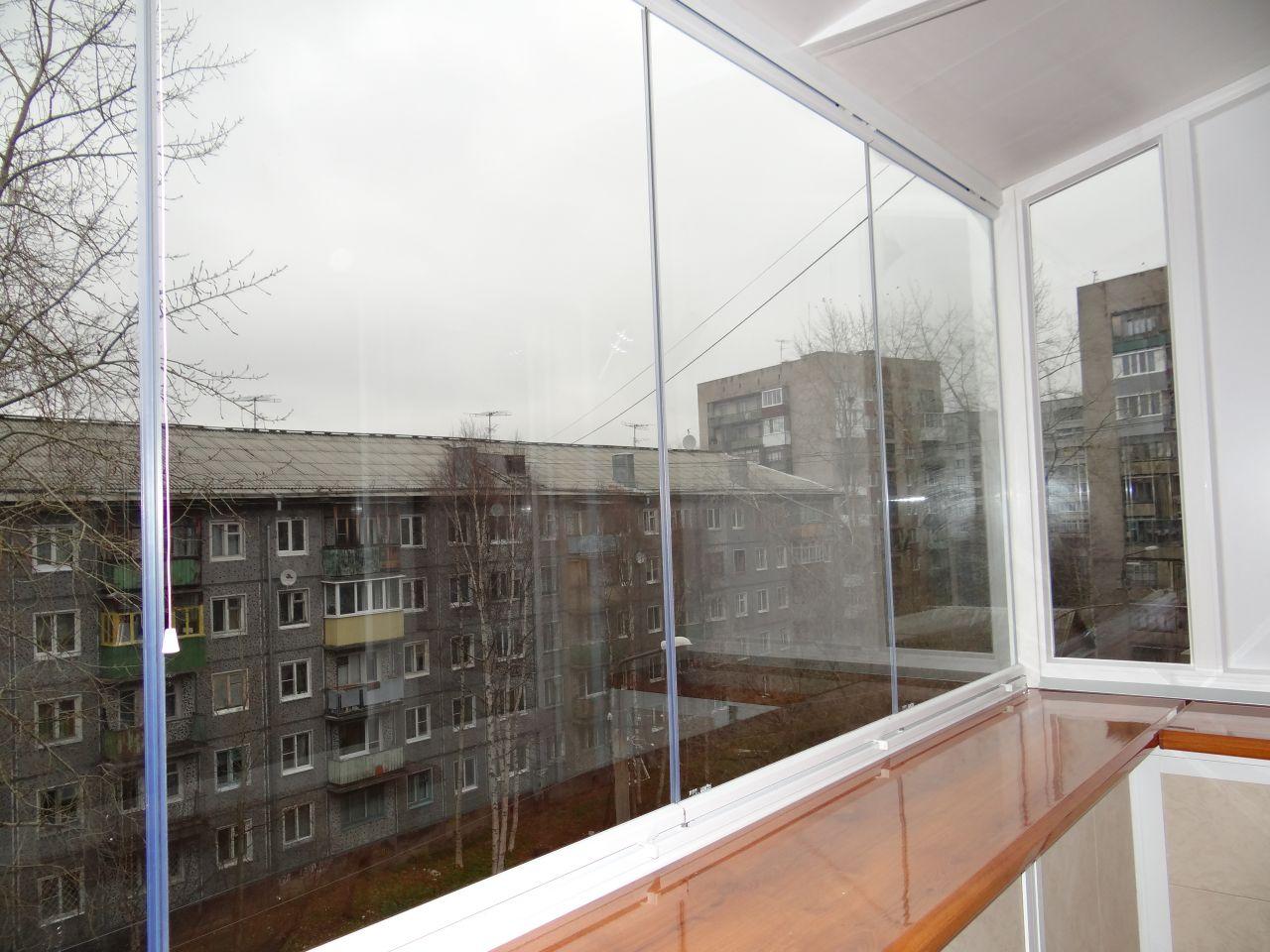 Безрамное остекление балкона. - готовые балконы - каталог ст.